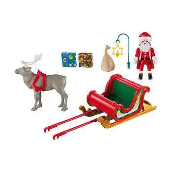 Санта в санях с северным оленем